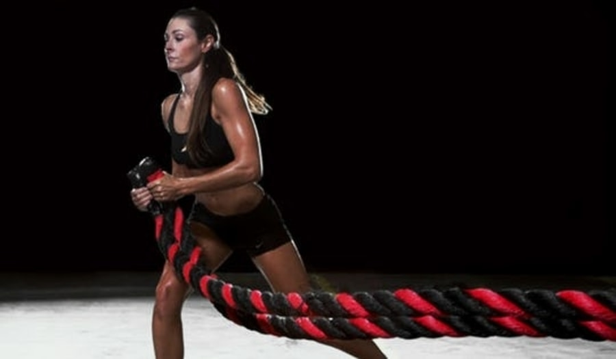 woman battle ropes