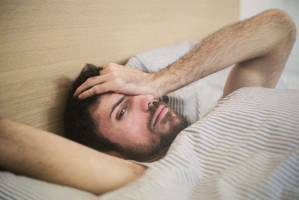 hungover man looking for hangover cure